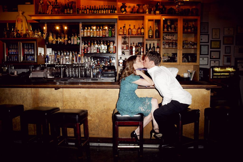 Engagement photo in a bar